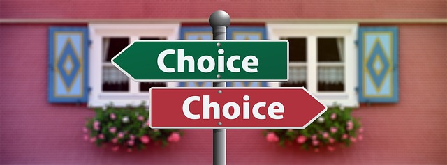 a sign showing different choices infront of a house