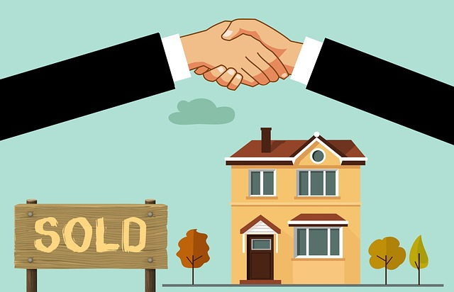 cartoon shaking hands over a sold house