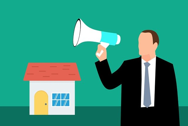 cartoon man with a megaphone and house