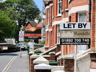street with 2 to let signs outside terraced houses