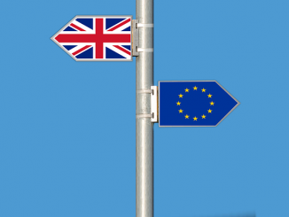 Pole with signs facing opposite ways, one with the British flag and one with the European flag