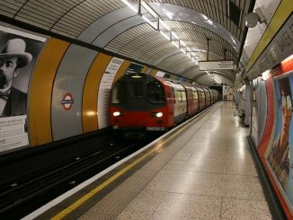 London underground with moving train at a station