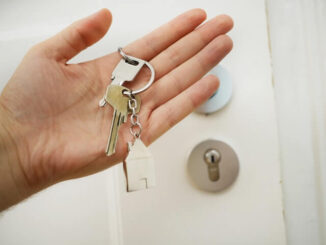 house key on chain in hand